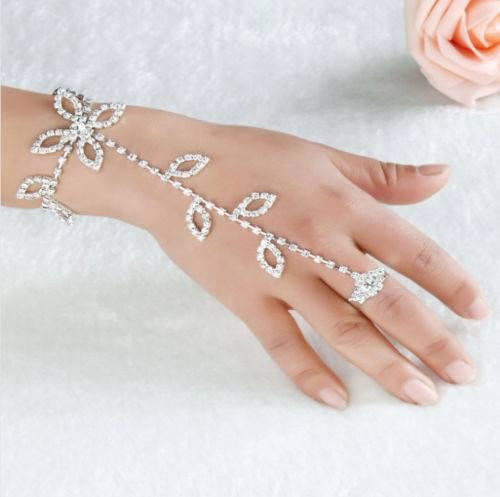 תכשיט ערב: צמיד וטבעת מחוברים בשיבוץ קריסטלים עיצוב עלים