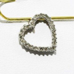 תכשיט לכלה ולערב: תליון זהב לבן 14 קרט בשיבוץ יהלומים 20. קרט עיצוב לב