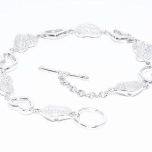 תכשיט לכלה ולערב: צמיד יוקרה כסף עיצוב לבבות משובץ 10 יהלומים לבנים